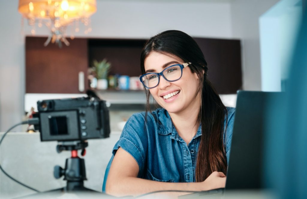Young Woman Doing Web Meeting Using Mirrorless Camera